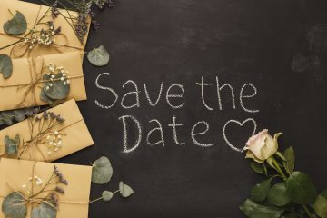 Border of wedding envelopes on black background